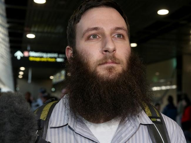 Musa Cerantonio was named by the ICSR as a 'spiritual leader' of IS. Pictured, he arrives in Melbourne after being deported from the Philippines.