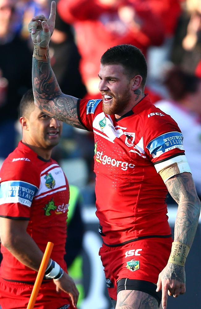 Josh Dugan celebrates after he claims a try.
