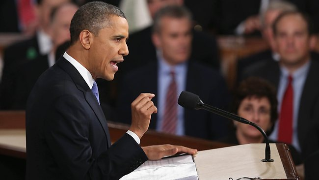"""WASHINGTON, DC - FEBRUARY 12: U.S. President Barack Obama delivers his State of the Union speech before a joint session of Congress at the U.S. Capitol February 12, 2013 in Washington, DC. Facing a divided Congress, Obama focused his speech on new initiatives designed to stimulate the U.S. economy and said, """"It""""s not a bigger government we need, but a smarter government that sets priorities and invests in broad-based growth"""". Alex Wong/Getty Images/AFP== FOR NEWSPAPERS, INTERNET, TELCOS & TELEVISION USE ONLY =="""