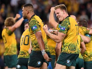 Reece Hodge of the Wallabies (right) reacts following Australia's win in the Rugby Championship, Bledisloe Cup match between the Australian Wallabies and the New Zealand All Blacks at Suncorp Stadium in Brisbane, Saturday, October 21, 2017. (AAP Image/Dave Hunt) NO ARCHIVING