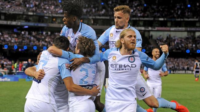 Melbourne City players celebrate after Tim Cahill's goal.