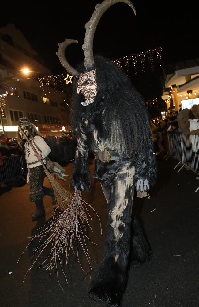 A man wearing a horned, wooden mask and dressed as the Krampus creature participates in the annual Krampus parade Picture: Getty