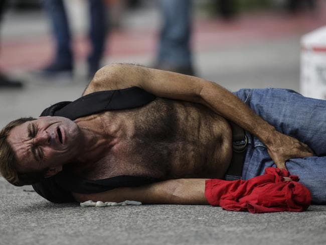 A man is winces in pain after he was shot by the Civil Police as looting rages across Vitoria. Picture: Diego Herculano/AP