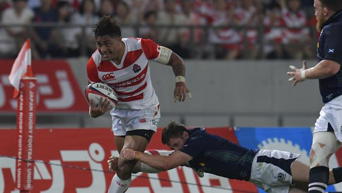 No 8 Amanaki Mafi runs with the ball during the international match between Japan and Scotland.