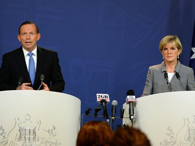 "Resolute: Tony Abbott speaks alongside Foreign Minister Julie Bishop, saying Russia could not ""wash its hands of responsibility"" for the Malaysia Airlines crash. AFP PHOTO / SAEED KHAN"