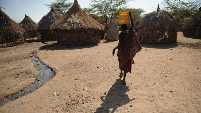 This 2009 picture shows a woman walking in the village of Lokwamosing in Turkana in Kenya's extreme north. (Pic: AFP PHOTO/ SIMON MAINA)