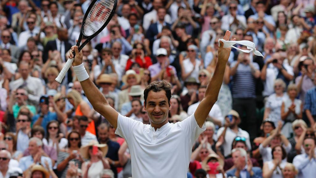 Roger Federer celebrates after winning against Croatia's Marin Cilic in the Wimbledon final.