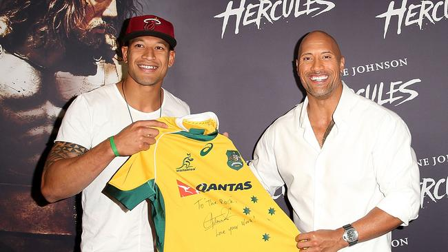 SYDNEY, AUSTRALIA - JUNE 19: Israel Folau presents Dwyane Johnson with a Wallabies jersey on the red carpet before the screening of Hercules at Event Cinemas George Street on June 19, 2014 in Sydney, Australia. (Photo by Mark Metcalfe/Getty Images)