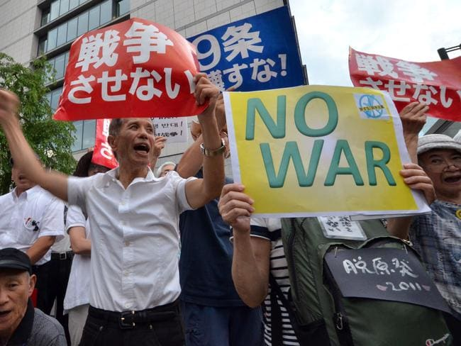 An anti-government rally in Japan protesting against the controversial security bills which would expand the remit of the country's armed forces. Picture: AFP/Yoshikazu Tsuno