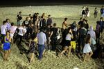 <p>A fight breaks out on the beach at Bryon Bay.</p>