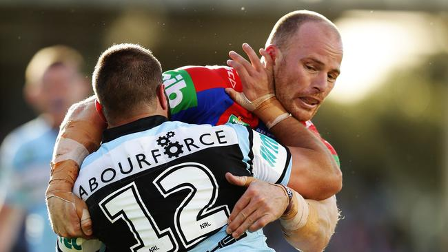 Newcastle's Beau Scott makes a tackle.