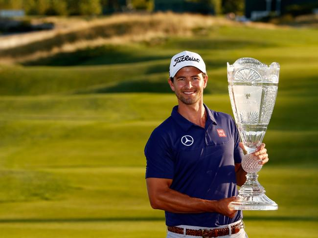 Adam Scott poses with the trophy after winning The Barclays at Liberty National Golf Club in 2013.