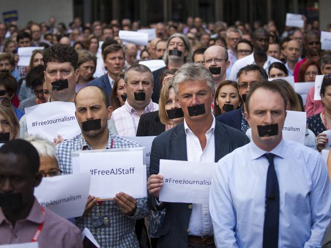 Press Freedom ... BBC's Director of News James Harding (right), joins staff and colleagues from other news organisations in a one-minute silent protest in London against the seven-year jail terms given to the three Al-Jazeera journalists. Picture: Getty