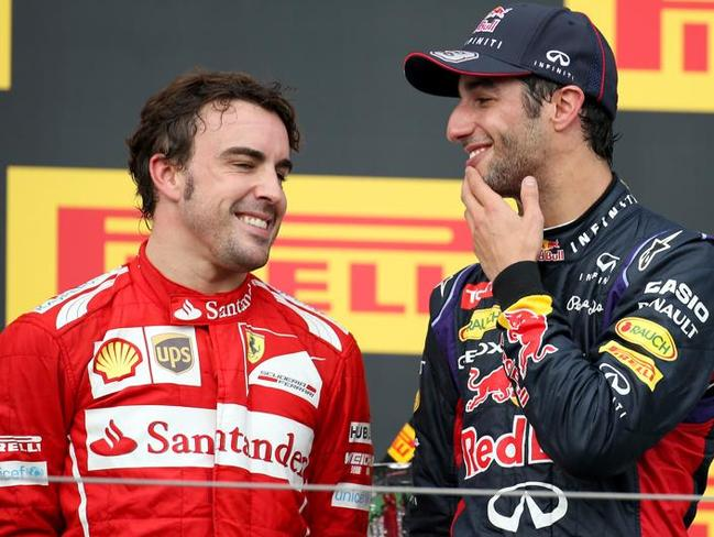 Alonso with Australia's Daniel Ricciardo, who is anything but bored at Red Bull.