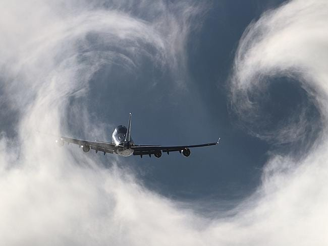 A Boeing 747 cuts through the heart-shaped clouds at Paris - the City of Love. Picture: AirTeamImages