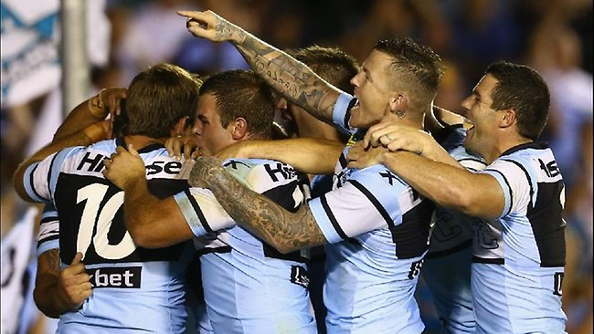 Sharks players celebrate Andrew Fifita's second half try.