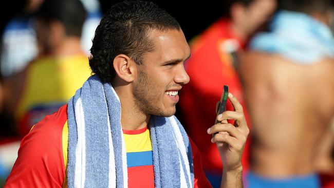 Harley Bennell enjoys a Gold Coast Suns recovery session at Kurrawa Beach. Picture: Adam Head