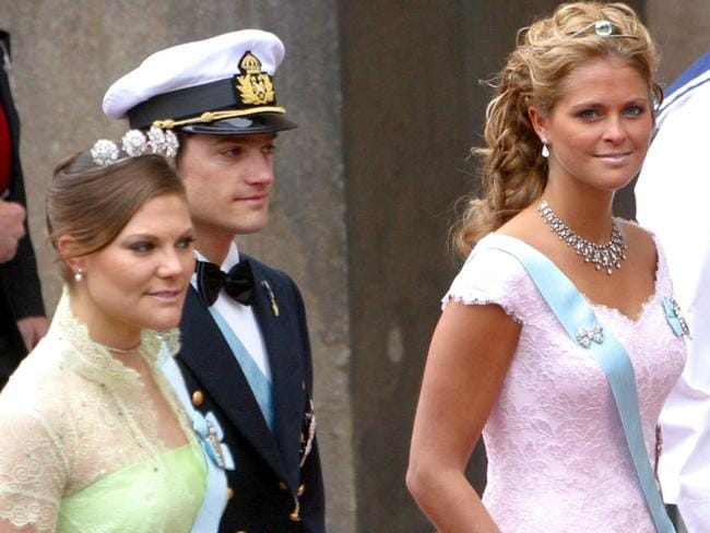 Sweden's Crown Princess Victoria, (L), Prince Carl Philip, and Princess Madeleine, (R), at the 2004 wedding of Denmark's Crown Prince Frederik to Mary Donaldson. Picture: AP