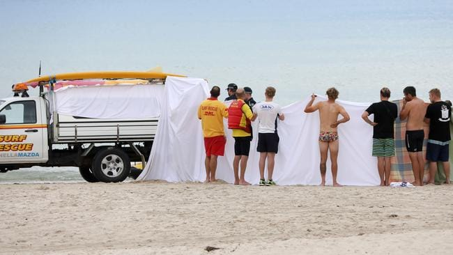 Lifeguards work on a 15-year-old boy who got into trouble off South Australia's Glenelg Beach. He didn't make it. Picture: Russell Millard
