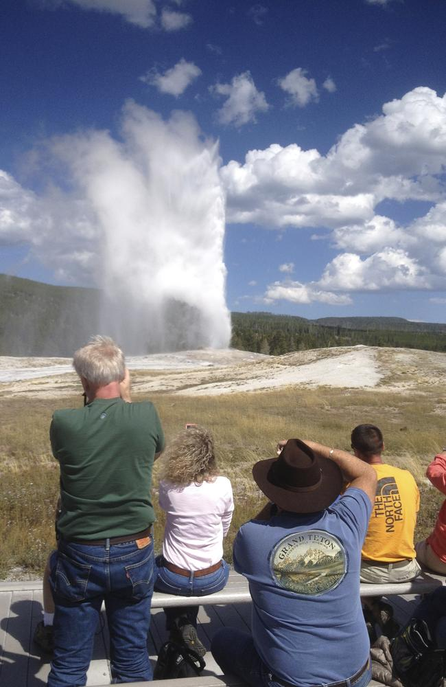 Visitors photographing Old Faithful geyser, which erupts every 91 minutes, unlike the less active Steamboat, which is more spectacular. Picture: Andy van Smeerdijk
