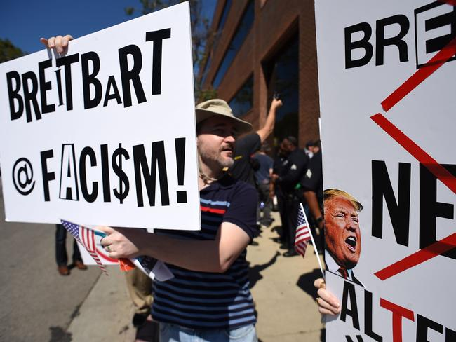 Protesters demonstrate on the street outside what they say is the offices of Breitbart News, formerly run by Trump administration chief strategist Stephen Bannon. Picture: AFP