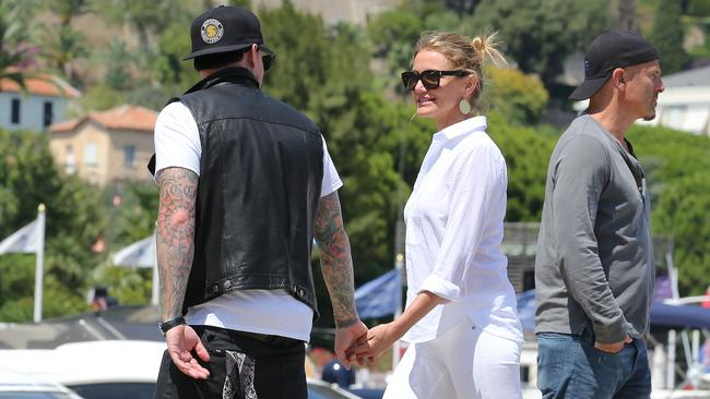Loved up Diaz and Madden spotted leaving their holiday yacht in Beaulieu, south of France. Picture: Splash News