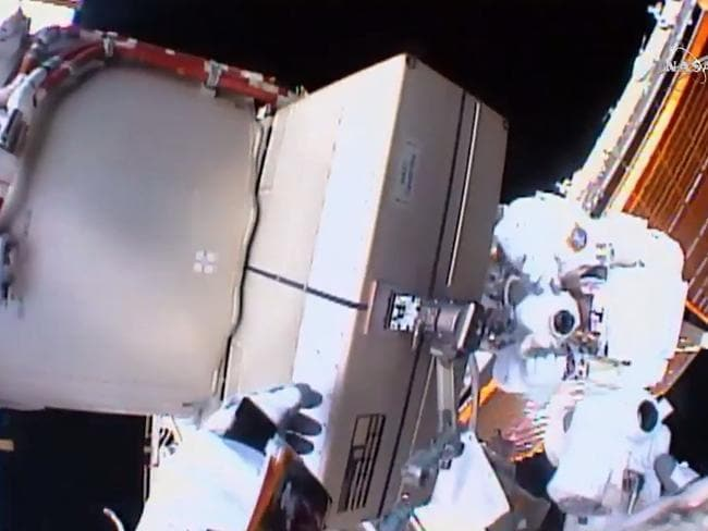Repairmen ... This NASA video grab shows astronauts Tim Kopra(L)and Tim Peake(R) as they replace a failed unit and equipment at the International Space Station. Picture: AFP