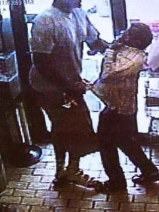 Police released CCTV images of a 'strongarmed' robbery taking place at a store in Ferguson minutes before teen Michael Brown was shot dead by Officer Darren Wilson.