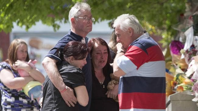 The family of murdered British soldier Lee Rigby grieve at the site of his death. Picture: AFP
