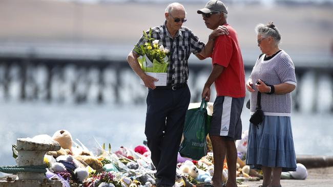 Melissa Little's elderly parents visit the memorial on the Port Lincoln wharf. Picture: Dean Martin