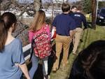 Students leave the campus of the Franklin Regional School District where several people were stabbed at Franklin Regional High School on Wednesday, April 9, 2014, . The suspect, a male student, was taken into custody and being questioned. Picture: AP