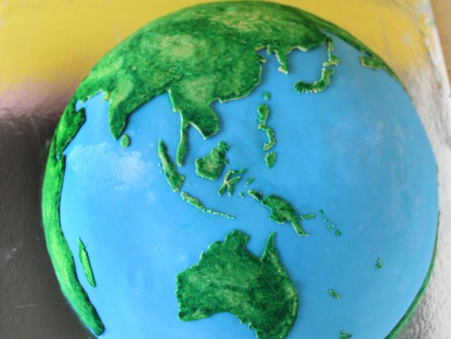 Planetary Cakes: A self-taught Melbourne chef has created incredible planetary cakes of Earth and Jupiter that are as scientifically accurate as possible. Photo: Rhiannon Michell/cakecrumbs.me