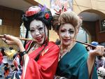 <p>People clad in special costumes pose for pictures during the Halloween Parade in Kawasaki, suburb of Tokyo. Picture: AFP PHOTO/Rie Ishii</p>