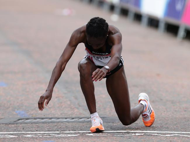 Naigambo's legs finally give way and she falls to the ground. Picture: Adam Head