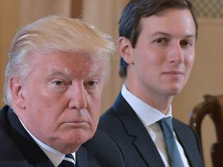 US President Donald Trump (L) and White House senior advisor Jared Kushner take part in a bilateral meeting with Italy's Prime Minister Paolo Gentiloni (not seen) in Villa Taverna, the US ambassador's residence, in Rome on May 24, 2017. After a private audience wit Pope Francis early in the morning Trump's family will fly to Brussels this afternoon for meetings with EU and NATO officials before returning to Italy for the G7 summit in Sicily on May 26-27. / AFP PHOTO / MANDEL NGAN