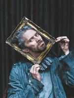 <p>James Thierree from theatre production <em>Raoul</em> posing with head in picture frame.</p>