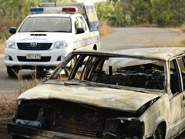 The remains of a burnt out car belonging to three German backpackers who were kidnapped, beaten and robbed while camping in the Northern Territory last August.