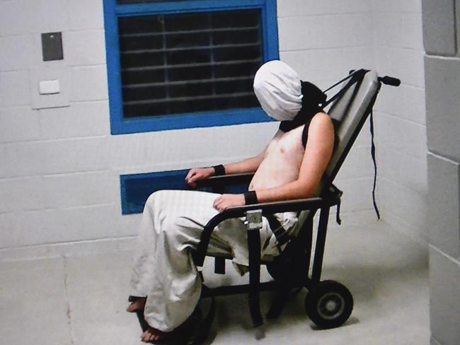 Footage from a 2016 ABC Four Corners report showed teenage boy Dylan Voller hooded and strapped into a chair at a youth detention centre in Darwin. Picture: ABC's Four Corners/AFP