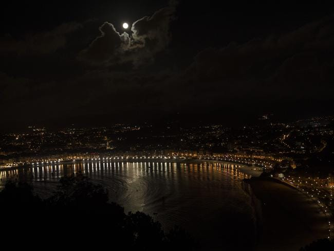 A perigee moon rises in the sky above the La Concha Beach, in San Sebastian, northern Spain. Picture: AP Photo/Alvaro Barrientos
