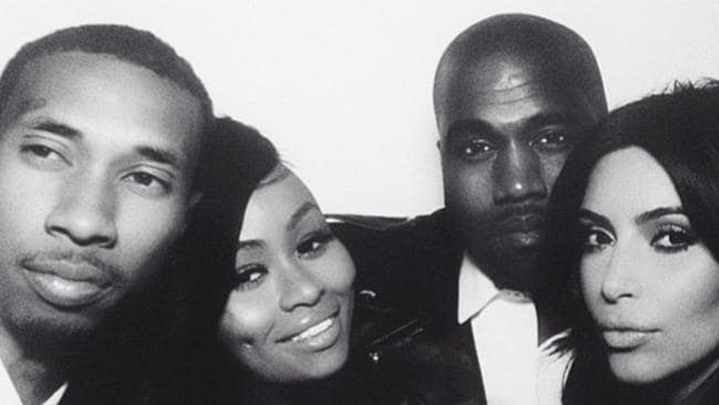 Happy couple ... Kim and Kanye pose in a photo booth at the wedding reception with rapper Tyga and his wife Blac Chyna. Picture: Instagram