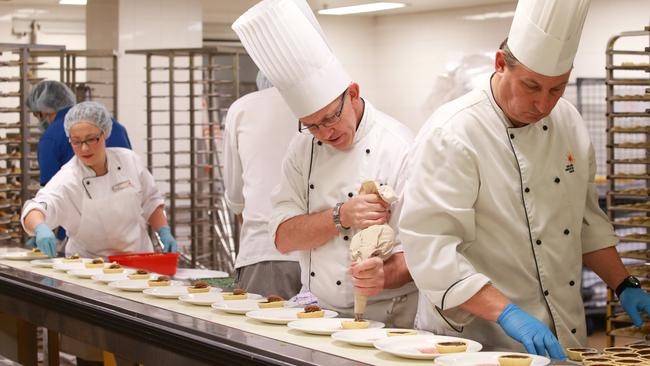 Convention Centre chefs work to prepare an impressive meal for 2000.