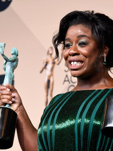 Orange Is The New Black star Uzo Aduba with her award for Outstanding Performance By a Female in a Comedy Series. Picture: Frazer Harrison/Getty Images