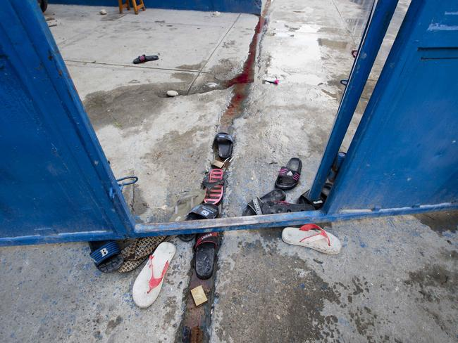 Inmates' sandals lay at the main gate of the Civil Prison. Picture: AP/Dieu Nalio Chery