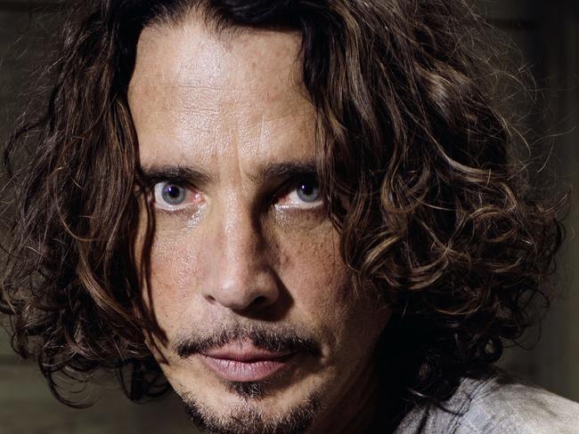 FILE - In this July 29, 2015, file photo, Chris Cornell plays guitar during a portrait session at The Paramount Ranch in Agoura Hills, Calif. Cornell's finale music video, filmed before the singer died in May, was released Tuesday, June 20, 2017. (Photo by Casey Curry/Invision/AP, File)