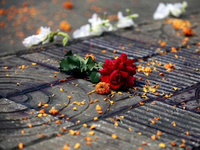 Memorialised ... flowers at the site where Avijit Roy was attacked and killed by assailants with meat cleavers. Picture: AP/AM Ahad