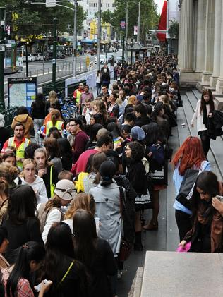 A long queue of eager shoppers formed in Elizabeth Street ahead of the opening. Picture: