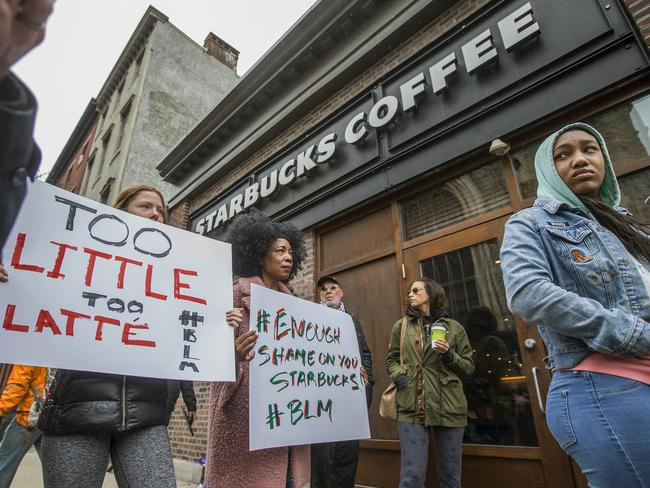Protesters gather outside of a Starbucks in Philadelphia, where two black men were arrested after employees called police to say the men were trespassing. The arrest prompted accusations of racism on social media. Picture: Michael Bryant/The Philadelphia Inquirer via AP