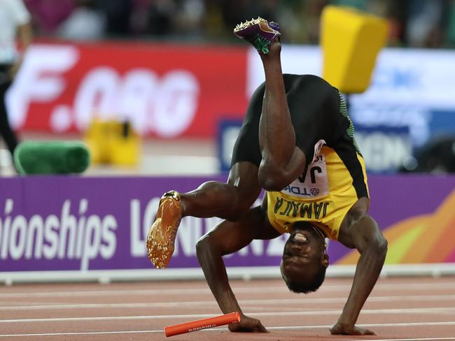 Usain Bolt falls after injuring himself in the final of the men's 4x100m relay.