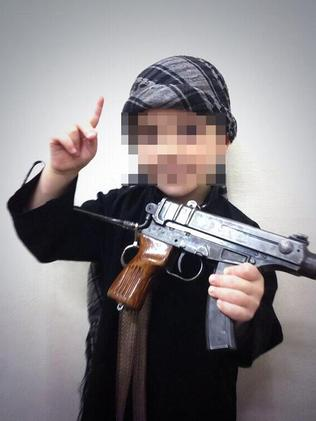 Sharrouf posted a photo of a young boy holding what appears to be an actual machine gun.
