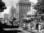 Pedestrians at the intersection of North Terrace and King William St in the city in 1955.